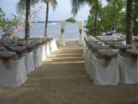https://www.jamaica-reggae-music-vacation.com/Beach-Jamaica-Wedding.html, Wedding decorations on the beach at Riu, Negril, Jamaica